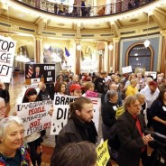 More than 200 protest Branstad's pro-corporate agenda